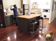 Image of a customer in her kitchen designed by Q Designs