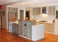 Image of a modern, white granate kitchen, designed by Q designs